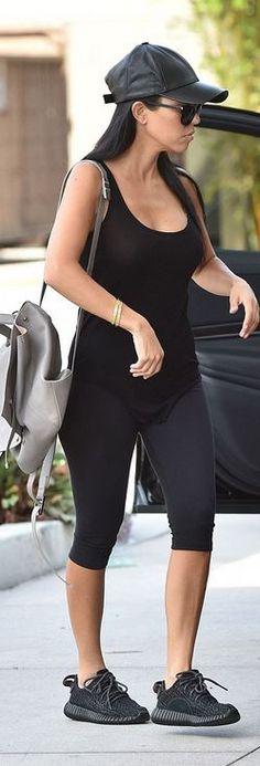 Kourtney Kardashian: Braclet – Cartier  Purse – Proenza Schouler  Shoes – Adidas  Shirt – Rick Owens