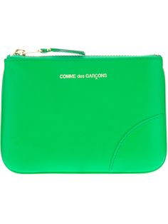 Light green calf leather purse from Comme des Garçons featuring a gold-tone top zip fastening and a gold-tone logo embossed detail.