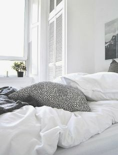 Fresh white room with spotty cushion | @styleminimalism