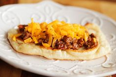 Cheeseburger Flatbread Melts..... Looks so yummy  1/2 lb lean ground beef, browned and drained  1/4 cup water  1/2 tbsp apple cider vinegar  1 pkg dry onion soup mix  1/4 cup ketchup  1 tbsp mustard  1 garlic clove, minced  2 tablespoons canola or vegetable oil  11 oz thin crust pizza dough  1 cup shredded cheddar cheese