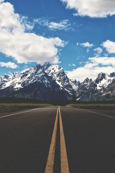A road leading towards snowy mountains - via www.murraymitchell.com