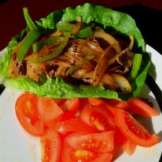 Chili-lime beef strips, sautéed onions & peppers, romaine lettuce leaf with a side of peppered tomatoes, spicy deliciousness!