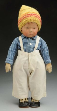 """17"""" redressed cloth Type I doll, with wide swivel hip joints, Germany, 1915-25, by Käthe Kruse."""