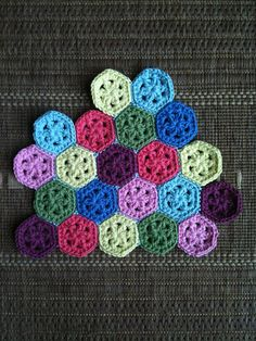 cute little six sided chrochet thingies.  Would make an adorable pillow.