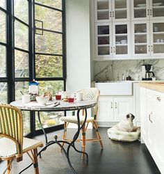 Love Katie Lee Joel's Brooklyn kitchen with floor to ceiling windows and my favorite french bistro chairs!