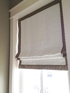 Greek key trim on edge of roman shades.