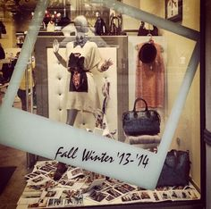 I love this window display. It is very eye-catching and I love the Polaroid, it's very different.