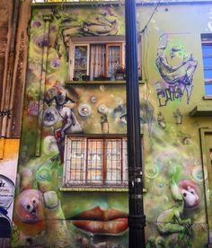 Beings and a woman's face @arty.city #barriobellavista #chile #streetartistry #artstreet #arteurbano