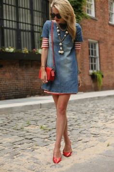 Denim dress.  Love the longer striped dress peeking out from the sleeves and below.