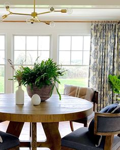 Bright warmth makes this inviting space the perfect place to spend a holiday at home. Get the look at theshadestore.com // Design by Butler Rambusch Interiors Drapery, Curtains, Dining Room Windows, Elegant Dining Room, Custom Drapes, Butler, Perfect Place, Dining Table, House Design