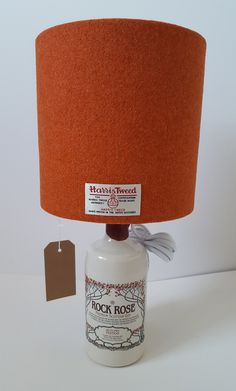 Harris Tweed Gin Bottle Lamp, complete lamp including bottle, burnt orange Harris Tweed lampshade and push in bottle adaptor, Scottish Gift by LucyWagtail on Etsy Bottle Lamp Kit, Bottle Lamps, Bottle Lights, Scottish Decor, Scottish Gifts, Stamp Storage, Gin Bottles, Harris Tweed, Light Fittings
