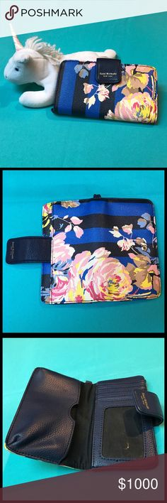 """IZAAK MIZRAHI New York Striped Flower Wallet Izaac Mizrahi New York Striped Flower Wallet  Good used condition Clean exterior & interior Wallet & phone case in one  Beautiful blue & black stripe w/flower designs  Interior left side holds phone/iPhone, size=6""""x 3 1/2"""" Right has 5 card slots, 1 is clear (perfect for ID/picture) + larger pocket behind card slots (6"""")  DIMENSIONS Length: 6 1/4"""" Height: 3 3/4""""  A wristlets handle can be added, but is not included.   🏆 Suggested User 💗Bundles…"""