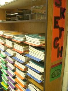 Sketchbook Storage    name: Hillary Andrlik  school: Walker Elementary  town: Clarendon Hills  state: IL    I took a book self and added laminated sheets in different colors with their teachers name on the end. Students store their sketchbooks on the same color as the table they sit at. This system makes it very easy for students to find and store their sketchbooks.