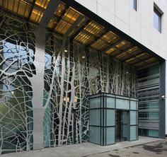 An organic motif was also used when designing this metal screen facade. It was carved to resemble trees and branches and to be reminiscent of a forest for Victoria Center/Bucharest.