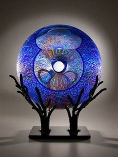 "David Schwarz Tree in Blue 8-26-13     2013 blue glass over clear glass, forged steel base 26"" x 14"" x 9.5"""