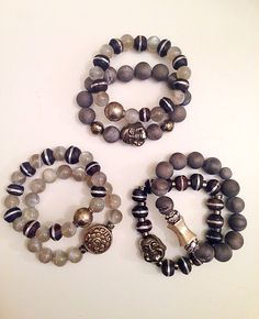 Beaded bracelets with pyrite Buddhas and other assorted gemstones.