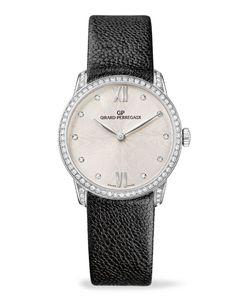 La montre 1966 Lady de Girard-Perregaux http://www.vogue.fr/joaillerie/news-joaillerie/diaporama/bale-horlogerie-baselworld-2013-montres-chanel-j12-burberry-tag-heuer-patek-philippe-girard-perregaux-bulgari-hublot/12937/image/748346#!bale-horlogerie-baselworld-2013-montres-girard-perregaux-1966-lady