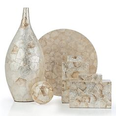 Grandiose in size and meticulously crafted out of lustrous capriz shells gives our Capri Collection a magnificent textured effect. Neutral i...