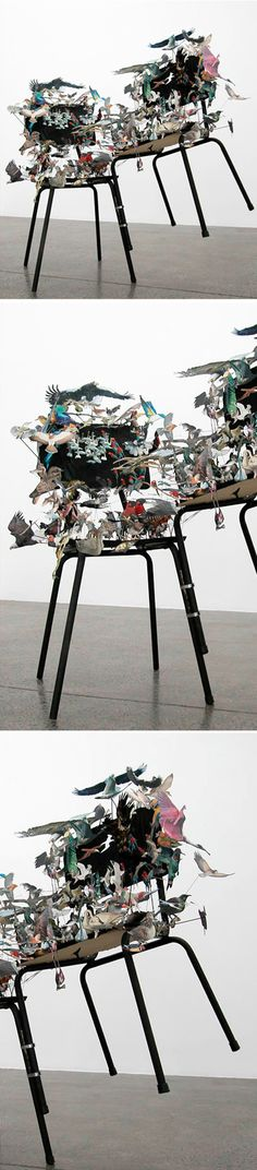 peter madden - chairs being carried away by hand-cut paper birds. whoa.