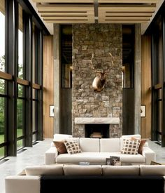 The grand, glass-walled great room is a loft-like space that incorporates living room and dining area. A bedroom and bathroom are located...