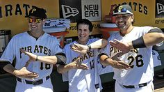 "Hal Sparks, the actor of ""Zoltan"" fame in ""Dude, Where's My Car,"" poses with Pirates' Neil Walker and Rod Barajas in the dugout before the start of the game against the Cubs this afternoon. Sparks threw out the first pitch."