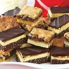Nanaimo Bars. Never heard of them? They're very popular in Canada, but in America? Not so much, Nobody disputes the origin of these treats (Nanaimo, B.C.), but there's always an opinion on the exact ingredients. Delicious!