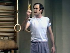John Cleese holds a banana in Self Defense Against Fruit sketch in Monty Python's Flying Circus