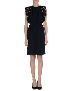 MIU MIU Knee-length dress | Has a dramatic, open back.