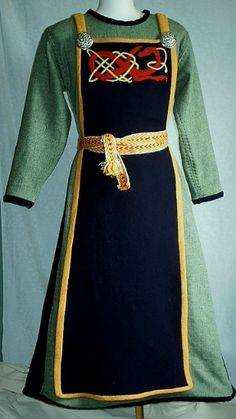 Cool different way of doing an apron dress - I like the embroidery and the color combination is interesting too!