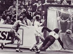 The Rockets first goal ever: Brian Alderson (8) watches intently as his shot heads toward the net past the NY Arrows' Gene Strenicer (13) and goalkeeper Shep Messing in the first game ever played by the Rockets in the MISL (11/13/81)