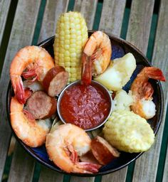 FROGMORE STEW (also called LOWCOUNTRY BOIL) is a SIGNATURE GULLAH DISH. The Gullah who live on South Carolina's coastal plain and sea islands – the lowcountry –have famously preserved much of their African heritage. Frogmore stew is a signature Gullah dish – a mixture of crab, shrimp, sausage, corn and spicy seasonings named after a small town on St. Helena Island, the center of Gullah life. / Photo courtesy of South Carolina Department of Parks & Tourism