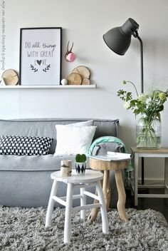 neutral colours - grey, white, black and wood, with a tiny pop of colour