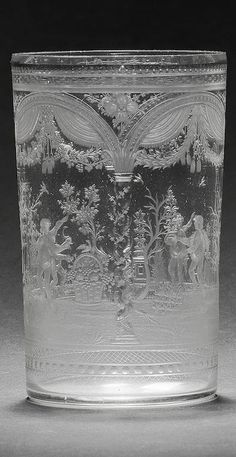 A fine Bohemian Four Seasons beaker by Franz Riedel, Isergebirge, circa 1800-10 Of plain cylindrical form, engraved with four arched panels separated by twisted columns adorned with flowers, each panel enclosing a putto flanked by flowers and plants appropriate to the season, below fancy drapery and floral swags also representing the different seasons, formal borders at the rim and base, 11.8cm high