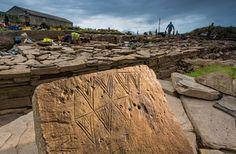 Archaeologists excavating the Ness of Brodgar uncovered the richest collection of Neolithic art yet found in Britain, including this decorative stone incised with a geometric motif. Photograph by Jim Richardson. Ness of Brogdar photographed with permission of the Archaeology Institute, University of the Highlands and Islands
