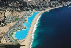 The Crystal Lagoon, located at the San Alfonso del Mar resort in Algarrobo, Chile, is the world's largest outdoor pool, stretching more than half of a mile and filled with 66 million gallons of water..!