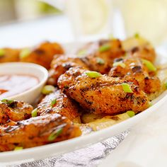Planning a Super Bowl party this weekend? Here are 5 creative takes on the game-day staple score big on taste and creativity, like this Polynesian Glazed Chicken Wings recipe. #superbowlrecipes #everydayhealth | everydayhealth.com