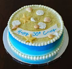 seashells and sand birthday cake by Snacky French
