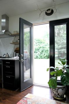kitchen doors Black doors // outside: evening hush by behr, inside: deepest black by glidden Kitchen Doors, House Tweaking, House, Interior Barn Doors, House Entrance, French Doors Exterior, Doors Interior, Exterior Doors, Internal French Doors
