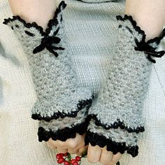 """Victorian crocheted fingerless gloves are made of soft Alpaca dark gray wool and trimmed with black acrylic. Might adorn your hands at the office and will keep your hands warm with elegance and style outside. They are extremely soft and warm, cozy, stylish, absolutely feminine and charming.    For better result use hand wash only in warm water. Dry flat.  Gloves fit S and M sizes.  Approximate Measurements:  Length: 10"""" (25.5 cm)  Width around wrist: 6"""" (15 cm)  Width around hand: 10"""" (25…"""
