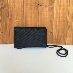 """Small black purse Small black shoulder bag with basket weave design on front panel. Great bag for a formal event (I carried it to homecoming dance in high school). Great condition, only carried once, no flaws.  Measurements: Height 4 3/4"""", Width 7 1/2"""", Depth 1-2"""" depending on contents, Strap drop 21"""". No trades. Lord & Taylor Bags"""