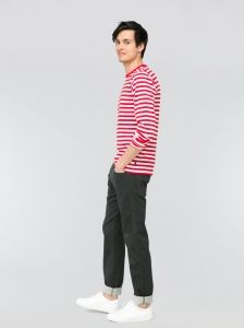 A symbol of the agnès b. style. Sailor-style t-shirt with narrow stripes in cotton jersey. Machine washable. In 1975, while researching into working clothes, agnès b. met a French manufacturer of rugby shirts. The designer decided to use their thick striped cotton fabric to make collarless tee-shirts which she dyed herself to produce special colours. This tee-shirt was one of her first successes. It has continued to appear in her collections ever since, in long or short-sleeved versions.