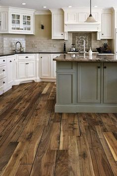 Farmhouse kitchen charm did not simply come about when Fixer Upper debuted. They have been around for a long time- check out these gorgeous small farmhouse kitchen ideas, farmhouse kitchen cabinets, farmhouse style kitchen to get inspired now! Wood Floor Kitchen, Kitchen Paint, Home Decor Kitchen, Kitchen Flooring, New Kitchen, Kitchen Cabinets, Kitchen Ideas, Awesome Kitchen, Kitchen Trends