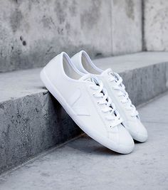 Veja   An ethical sneaker brand.   Socially Responsible:  Works with Marginalized Communities  Does not advertise Uses organic cotton purchased from a small scale farmers' Coop  Sustainable: Sustainably harvested rubber  Leather from cows that aren't farmed on deforested rainforest land Produces on demand to reduce waste  CO2 reduction