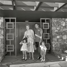 "1954. ""Actress Lucille Ball and husband Desi Arnaz with children Desi Jr. and Lucie in front of their Palm Springs home."" Photo by Maurice Terrell for the Look magazine assignment ""Lucy Goes Shopping."""
