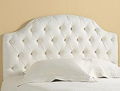 I like this headboard and would be easy DIY. I like the tuffeded (sp)? Not sure about the top line though? White for a 3 year old though?