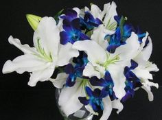 white bouquet with blue accents - Google Search