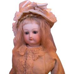 This is a really sweet and pretty French Fashion doll with lovely cobalt blue glass eyes, pale coloring, and a round face having a hint of the Bru