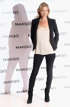 Kate Moss Model Kate Moss poses for photographs at the Mango Store Oxford Street on January 24, 2012 in London, England. Kate Moss was today launched as the new face of the fashion brand.