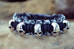 5 Skull Handmade in the USA Paracord Bracelet Comes with a Hidden Handcuff Key Buckle Made with 550 USA Paracord  *When measuring wrist size,