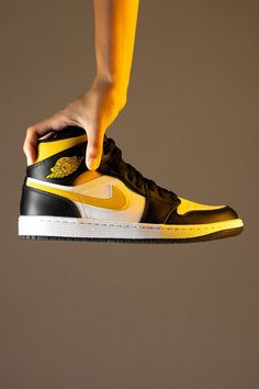 """Whether offered in expressive colorways or more classic arrangements like the """"Black/University Gold"""" seen here, the Air Jordan 1 Mid is the most creative canvas in Jordan Brand's lineup. And that shouldn't change anytime soon."""